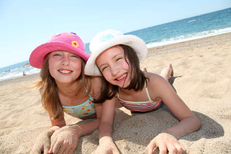 summer girl: Happy little girls at the beach