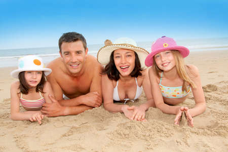 Portrait of happy family at the beach Stock Photo - 9903357