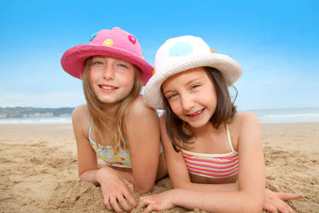Young girls laying down at the beach Stock Photo - 9903103