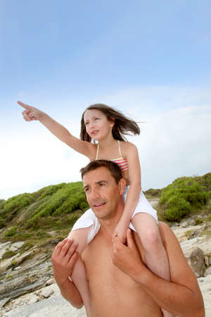 Father carrying daughter on his shoulders Stock Photo - 9902745