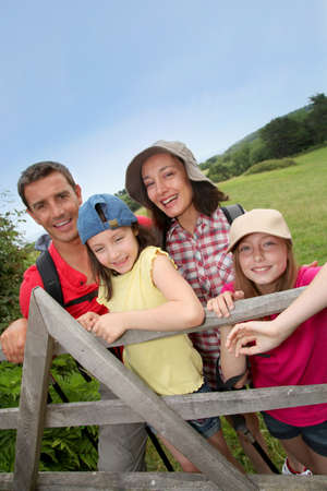 Family portrait standing by a fence photo