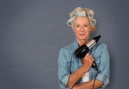 Portrait of senior woman with hair-curlers photo