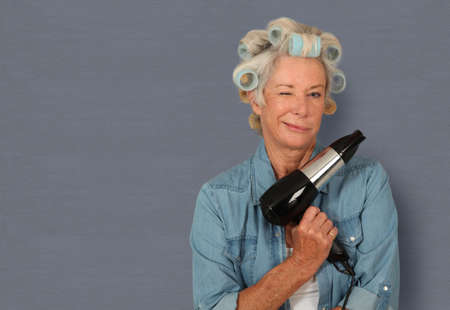 grandmas: Portrait of senior woman with hair-curlers Stock Photo