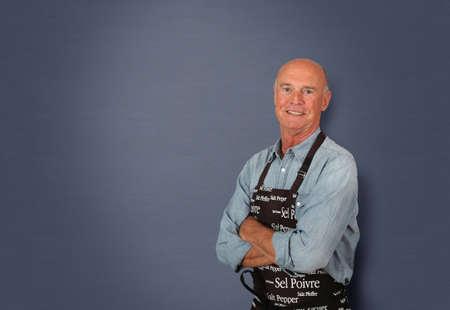 winemaker: Portrait of senior winemaker holding bottles of wine