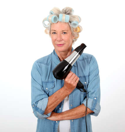 haircurlers: Portrait of senior woman with hair-curlers Stock Photo