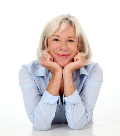 textspace: Portrait of smiling senior woman with blue shirt Stock Photo