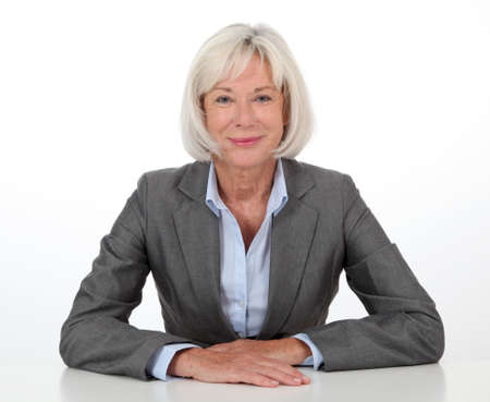 senior business: Portrait of businesswoman on white background