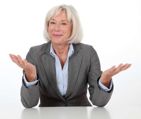 inquiring: Portrait of businesswoman on white background