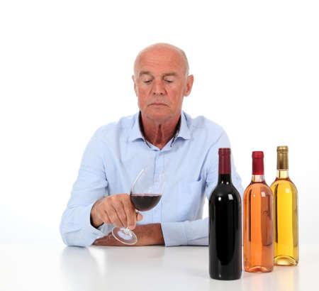 Portrait of winemaker tasting wine photo