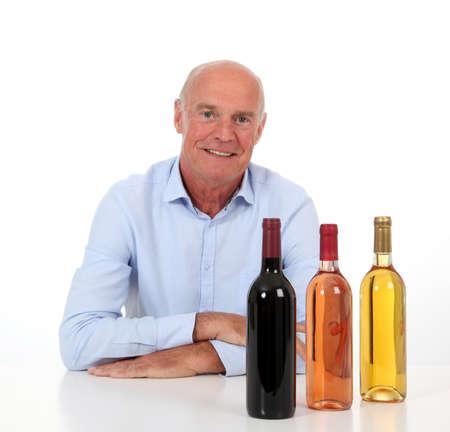winemaker: Portrait of winemaker with bottles of wine Stock Photo