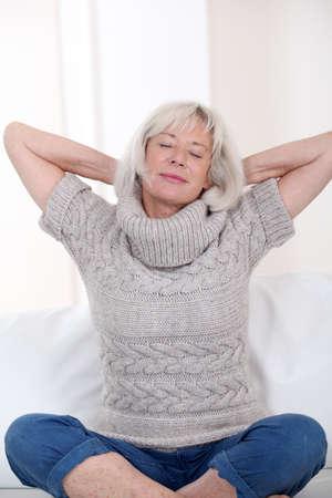 Senior woman stretching arms photo