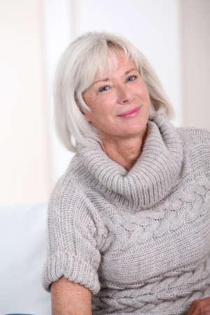 Portrait of smiling senior woman photo