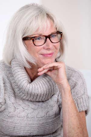 Portrait of smiling senior woman with eyeglasses photo