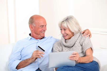 Senior couple doing online shopping photo