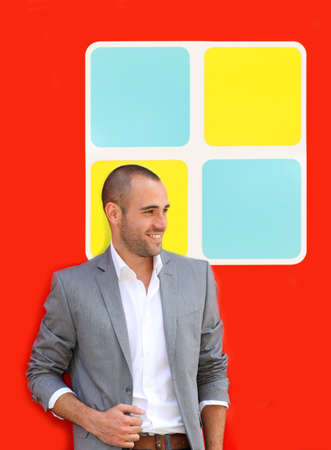 Handsome man standing on colorful wall Stock Photo - 10013754