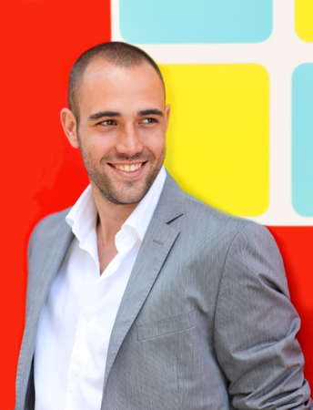 Handsome man standing on colorful wall Stock Photo - 10013697