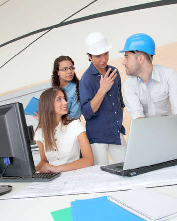 Group of young architects in business meeting photo
