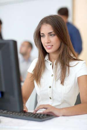 computer lab: Portrait of student in front of desktop computer