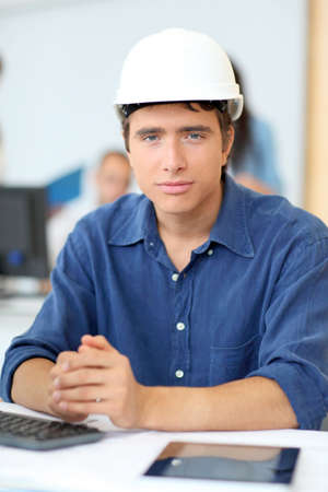 classroom training: Portrait of student architect with security helmet on