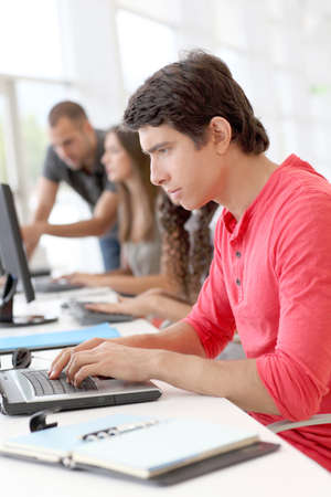 Student in class using laptop computer Stock Photo - 10013707