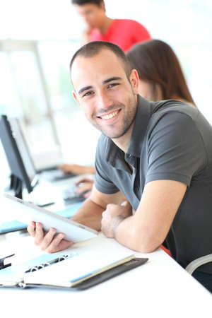 computer lab: Portrait of smiling student in training course Stock Photo