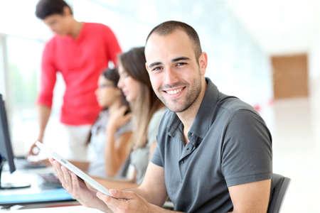 Portret van glimlachende student in opleiding Stockfoto