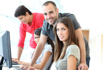 computer classroom: Group of young people in training course