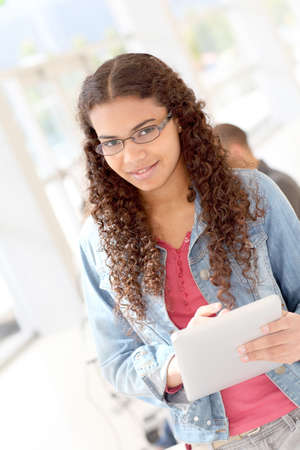 latina girl: Student using electronic tablet at school Stock Photo