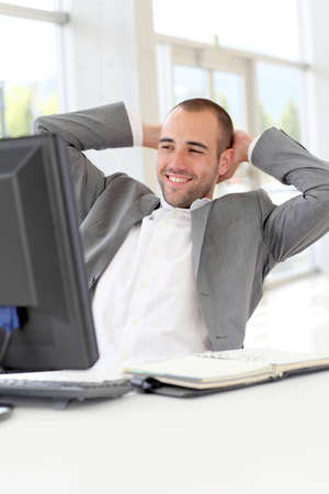 officeworker: Portrait of relaxed salesman in office