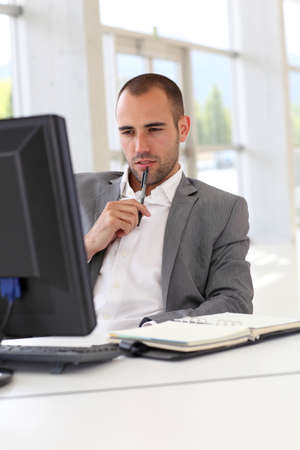 Portrait of concentrated businessman at work photo