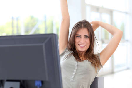 employees working: Relaxed young woman at work