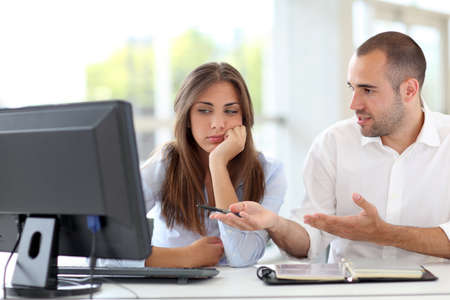 Office workers arguing on project photo