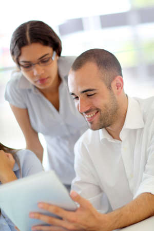 Young adults in training course using touchpad Stock Photo - 10013768