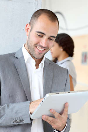 Young businessman using electronic tablet Stock Photo - 10013553