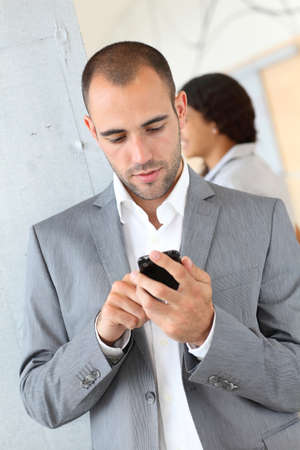 Portrait of businessman using mobile phone photo