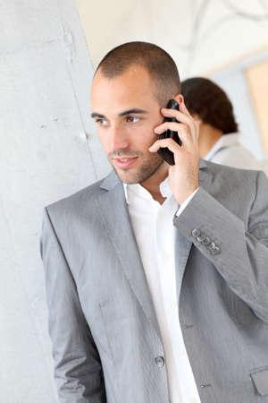 telephone salesman: Portrait of businessman using mobile phone Stock Photo