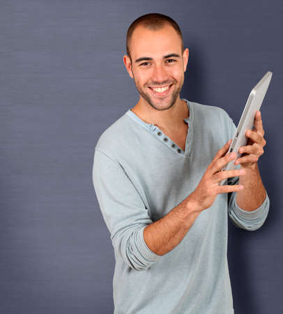 30 years old man: Young man holding touchpad