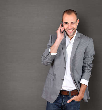 Cool businessman talking on mobile phone Stock Photo - 10013551