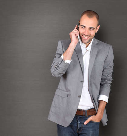 Cool businessman talking on mobile phone Stock Photo - 10013399