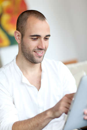 touchpad: Closeup of handsome man websurfing on touchpad