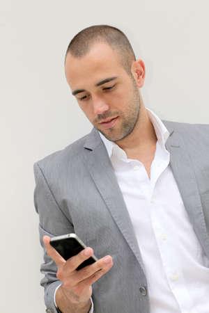 Handsome salesman talking on mobile phone photo