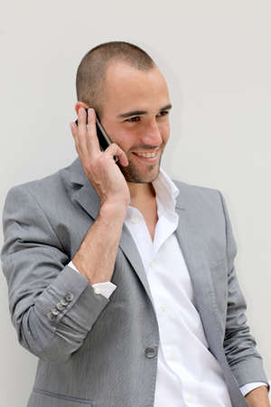 30 years old man: Handsome salesman talking on mobile phone Stock Photo