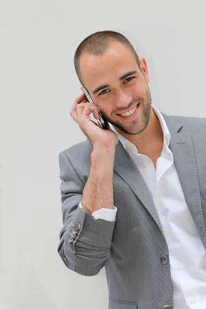 telephone salesman: Handsome salesman talking on mobile phone Stock Photo