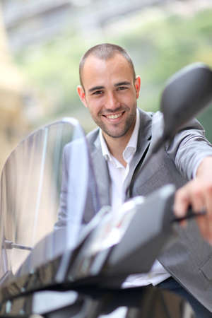 Man going to work on motorcycle Stock Photo - 10013678