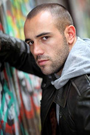 Portrait of bad boy in suburb street photo