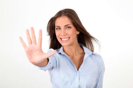empujando: Retrato de una ni�a que muestra la mano a la c�mara