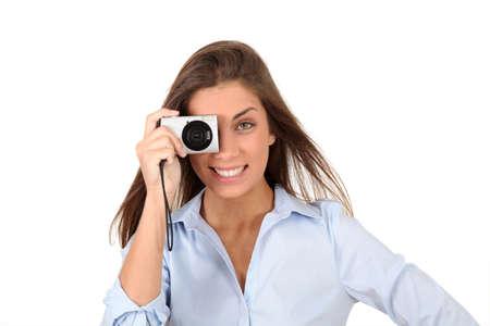 compact camera: Portrait of beautiful woman using compact digital camera