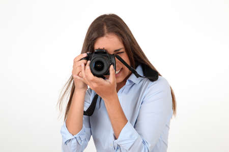 Portrait of woman using reflex digital camera photo