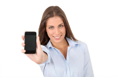 hair product: Portrait of beautiful young woman holding smartphone