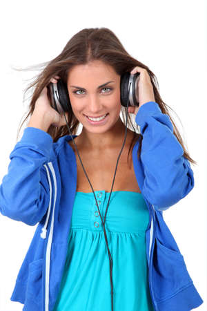 Portrait of teenager listening to music with headphones Stock Photo - 10285358